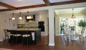 white kitchen with black island designing a traditional kitchen with cabinet and island also