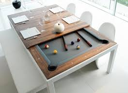 this kitchen has a dining pool table combo