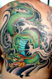 colored green ink dragon tattoo on back