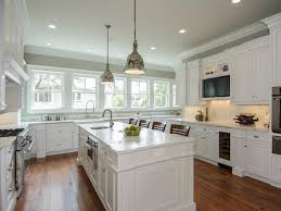 kitchens with white cabinets and dark floors kitchens with white