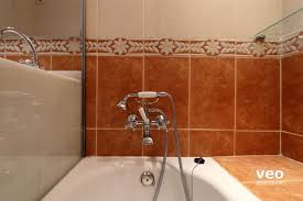 seville apartment cruz verde street seville spain macarena seville apartment main bathroom the bathtub has a shower attachment
