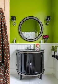lime green bathroom color ideas with round mirror and wall sconces