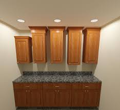 ceramic tile countertops soffit above kitchen cabinets lighting