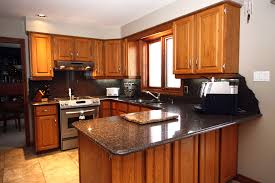 what color countertops with oak cabinets oak cabinets with granite countertops kitchen traditional with brown