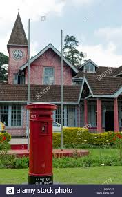 old post office building red pillar post box red brick stock