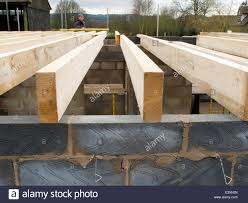 house builder self building house builder checking level of joists with