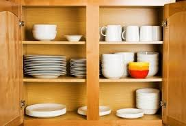 how do you arrange dishes in kitchen cabinets organizing kitchen cabinets thriftyfun