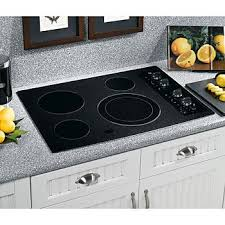 What Is An Induction Cooktop Stove Electric Vs Gas Cooktops Sears