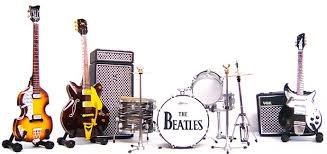 image of a drum set, guitar and speakers set-up on a stage