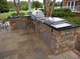 stainless steel cabinets for outdoor kitchens exteriors small outdoor kitchen decor with l shape brown stone
