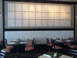 restaurant makeover with white brick creative faux panels