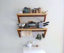 open metal shelves wall mounted dark wooden kitchen cabinet