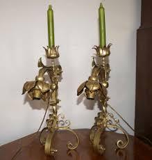 candelieri in ferro battuto coppia di lade candelieri in ferro battuto dorato asta