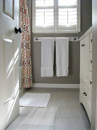 a light grey 12 x 24 tile in the bathroom and kitchen would be