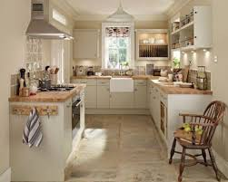 cottage kitchen ideas i the wood countertops and the coat hooks on the side of the
