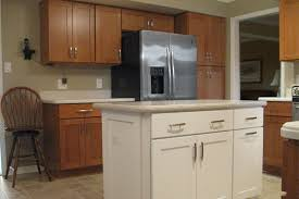 oak kitchen cabinets with white appliances home design and decor
