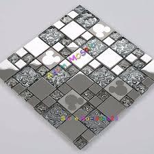 silver glass mosaic tiles mickey mouse mirror kitchen backsplash