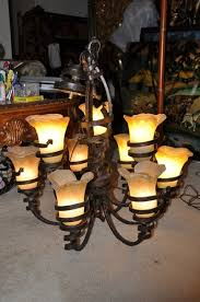 Tuscan Style Chandelier Rustic 9 Light Tuscan Style Iron Chandelier With Cup Shaped Flower