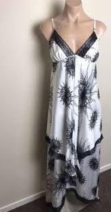 leona edmiston leona maxi dress in black with flowers at the