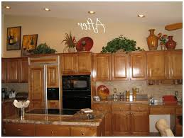 Above Kitchen Cabinet Ideas Awesome Ideas For Decorating Above Kitchen Cabinets For Christmas
