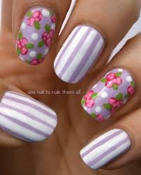 nail art style generic rose and stripes design