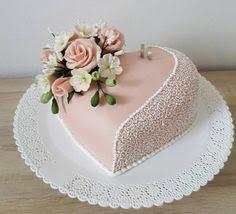 heart shaped wedding cakes heart shaped wedding cake with whimsical flowers fondant covered