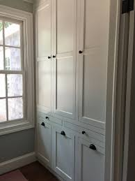 photos hgtv floor ceiling cabinets in mudroom with slate tiles