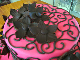 flower fondant cakes simple 2 tiered birthday cake close up on chocolate fondant flowers