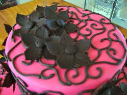 flower fondant cakes simple 2 tiered birthday cake close up on chocolate fondant flowers