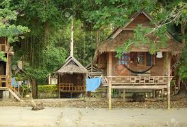 houses on stilts on a tropical beach in koh chang thailand stock
