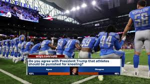 detroit lions players take a knee during national anthem