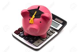 graduation piggy bank piggy bank with graduation cap and calculator isolated on white