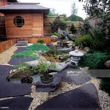 japanese style garden with pond giant slate stepping stone in