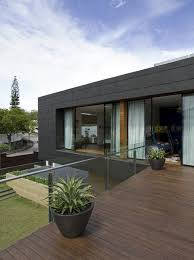 timber deck and glass railing in roof terrace design ideas photo