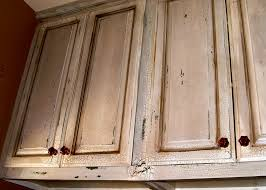 Distressed Wall Cabinet Creating Distressed Wood Cabinets Only With Paint And Wax Homesfeed