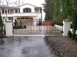 custom iron single swing gate with scroll patterns the hinges