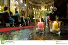 beautiful candles wedding decoration in a church stock image