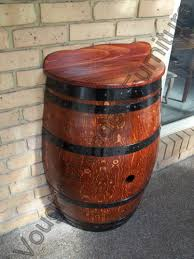 half wine barrel table built from a retired wine barrel cut in