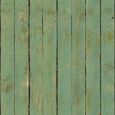 weathered turquoise planks with rotting sides and fading paint