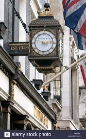 tiffany co shop store logo name sign on bond street with clock