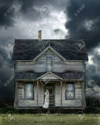 ghost on the porch of an old farmhouse during a storm stock photo