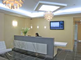 Grey Reception Desk Home Office Pale Yellow Wall Color With Adorable Chandelier For