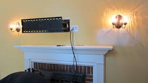 hanging tv above fireplace i like the efficiency of hanging tv