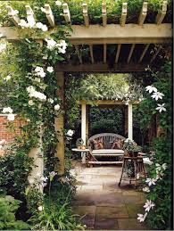 an arbor sitting area lush and natural patio design ideas
