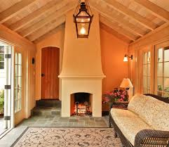 sunroom with fireplace traditional vaulted ceiling pedestal
