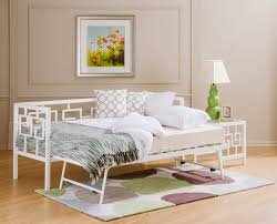 metal daybeds in a medallion and greek key design instyle