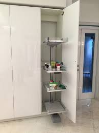 unique way to store items in floor to ceiling kitchen cabinets