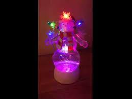 light up snow globe uk gardens light up sweets snowman snow globe with glitter battery