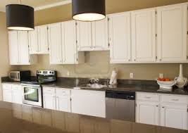 what color granite with white cabinets and dark wood floors black color metal handles built in stoves rectangle white leather