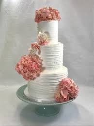 lateral textured buttercream wedding cake with hydrangea